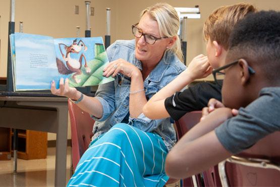 Photo of teacher reading to class