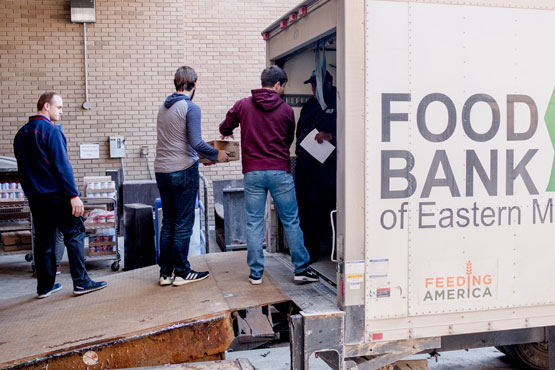 Social Work students helping to unload a Food Bank of Eastern Michigan truck.
