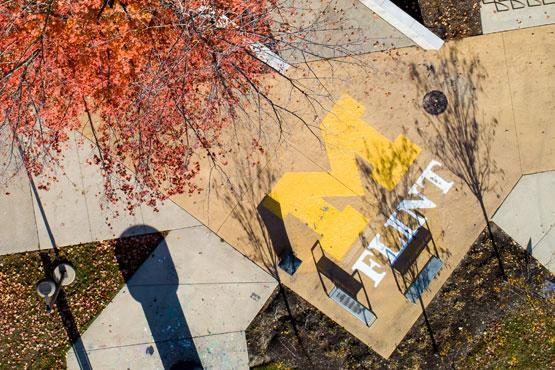 UM-Flint logo outside on campus