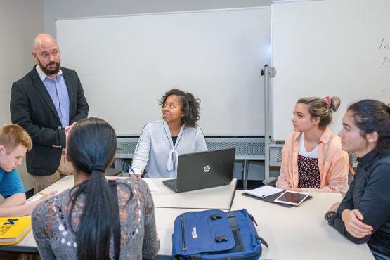 School of Management faculty member teaching a class.