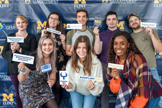School of Management students at an event.