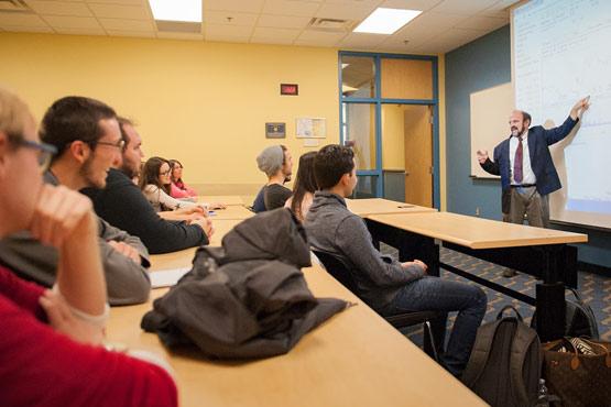 SOM faculty teaching a class.