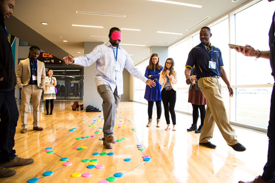 Finance students during a group activity at a conference.